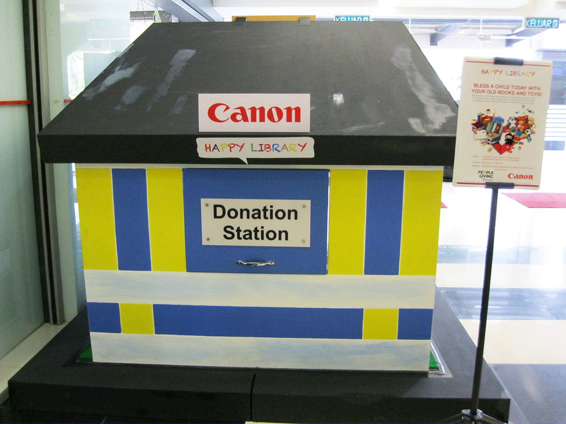 corporate social responsibility canon personal happy library book and toy donation campaign